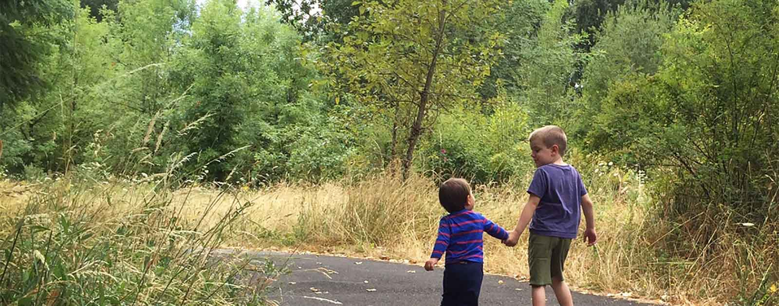 My sons exploring outside together | Amy Kober