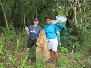 Volunteers comb the banks of the Ashley River for trash.Lowell George