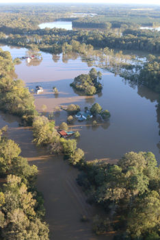 Flooding from Hurricane Matthew damages homes near Selma, North Carolina, October 12, 2016. | U.S. Army National Guard