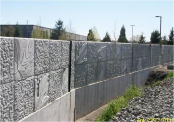 The King County Flood Control District, together with the cities of Kent and Tukwila, are choosing floodwalls and rip-rap bank armoring instead of sustainable levee designs that provide room for trees to shade the river. Image: Floodwall on Boeing Levee, completed 2013.   City of Kent, WA