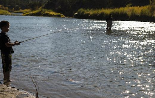Louie Hena and his grandson fish the Rio Grande River. | Dana Romanoff