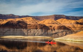 Kayaker paddles in front of Lake Powell's substantial 'bathtub ring.' | Photo: Sinjin Eberle