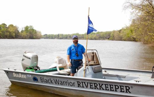 Black Warrior Riverkeeper Nelson Brooke on in the river in the patrol boat near Tuscaloosa.| Photo by John Wathen, Hurricane Creekkeeper