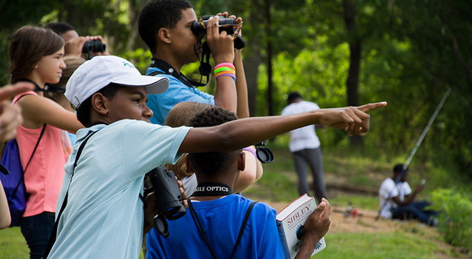 Children bird watching along the Pearl River in LeFleur's Bluff State Park. | Chris King
