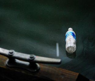 A water bottle floats in a river.   Chesapeake Bay Program