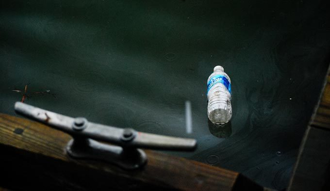 A water bottle floats in a river. | Chesapeake Bay Program