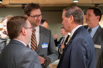 NRS Marketing Director Mark Deming talks with Jim Bradley of American Rivers and Senator Tom Udall.